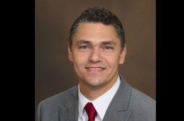 CHARLES E. PASCU  Financial Advisor