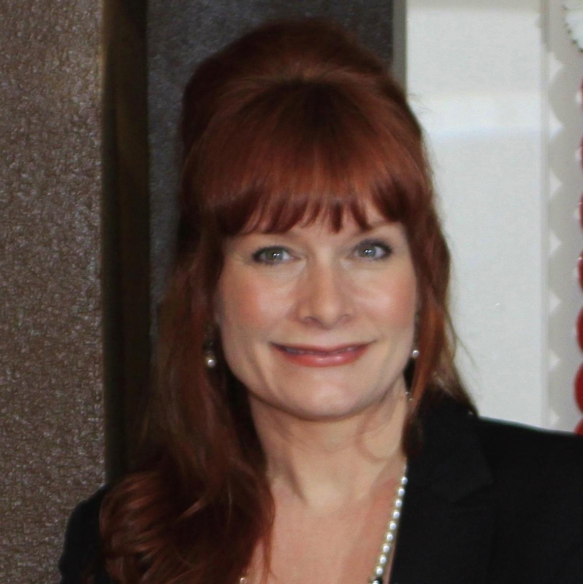 CHRISTINE SCHADER  Financial Advisor