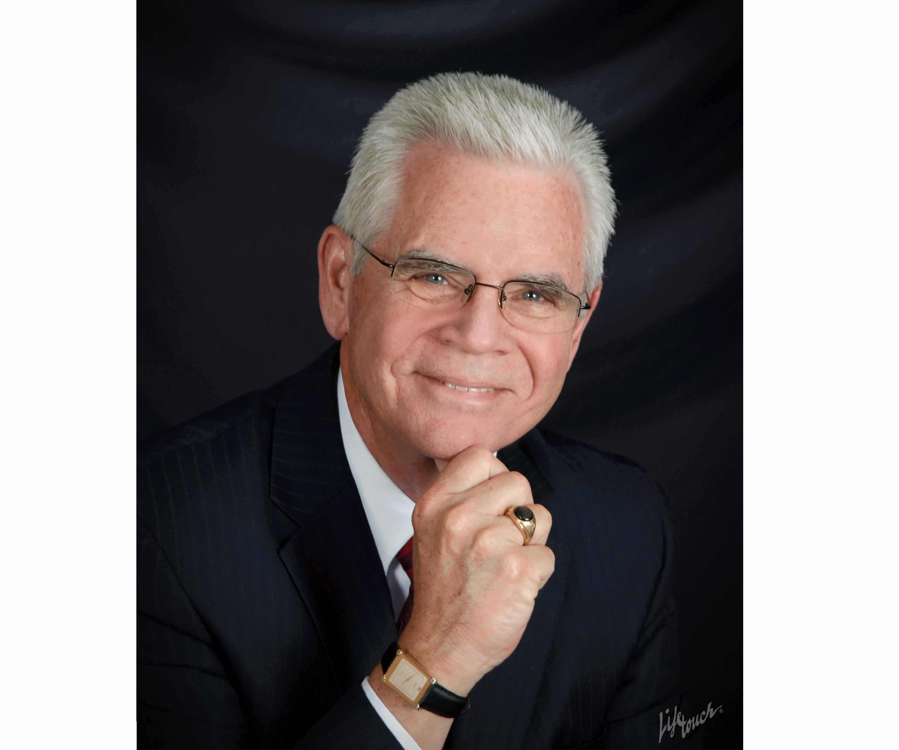 DAVID L. COMPAS  Your Registered Representative & Insurance Agent